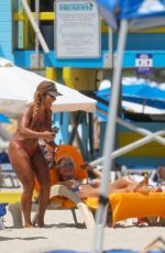 Maripily Rivera Works on her tan while enjoying the beach with friends in Miami
