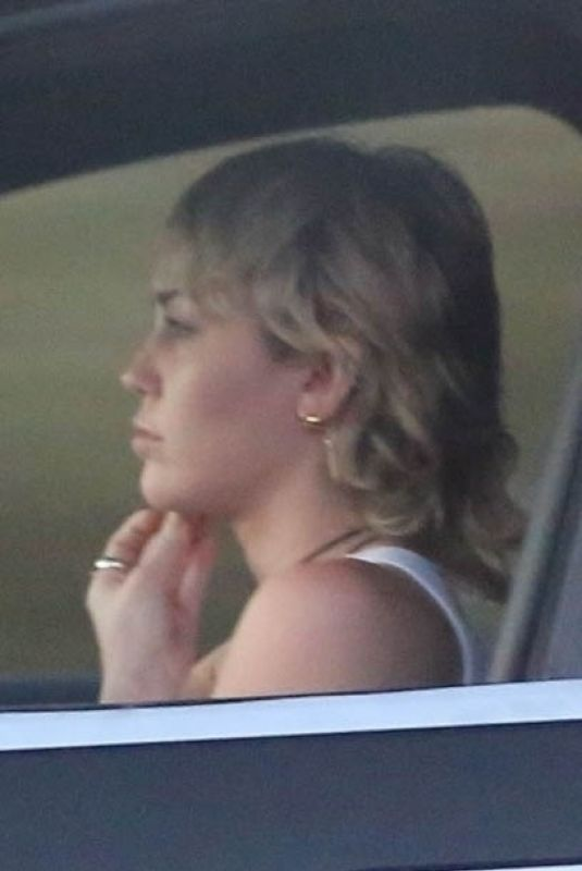 Miley Cyrus Driving around in Los Angeles