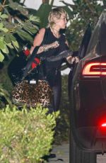 Miley Cyrus Looks like a rock star as she leaves a photoshoot in Beverly Hills