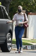 Milla Jovovich Carries a juice drink and sippy cup after visiting a friend in Los Feliz