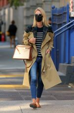 Nicky Hilton Rothschild Wearing a quirky trench coat with the top half exposed to the flannel lining in New York