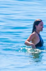 Olivia Wilde In a one piece swimsuit as she makes a splash with a friend in Malibu