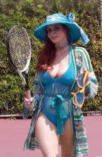 Phoebe Price Poses in a revealing outfit at the tennis courts