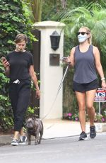 Reese Witherspoon Stays in shape as she goes for a morning power walk with her dog in Brentwood