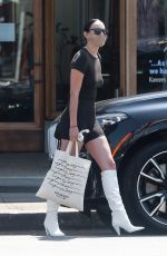 Rumer Willis In a black skin-tight outfit paired with white boots while shopping the day away in Los Angeles