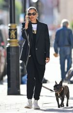 Shanina Shaik Is spotted taking a stroll with her super cute french bulldog in London