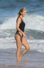 Taylor Neisen Looks perfect in an one piece black bikini in The Hamptons