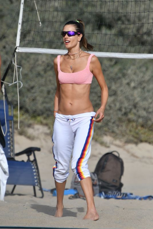 Alessandra Ambrosio Shows off her abs as she plays beach volleyball