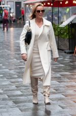 Amanda Holden Looks chic and stylish in a cream dress and coat outside the Global Studios in London