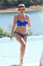 Amy Hart Shows off her recent weight loss in a skimpy blue bikini out in Portugal