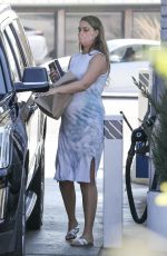 April Love Geary Making a pit stop at the gas station to fuel up the family SUV in Malibu