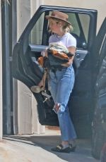 Ashley Benson And G Easy grab a coffee before taking bags into G Easy