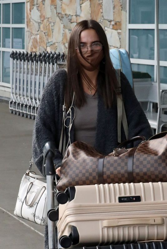 Bailee Madison Catch a departing flight out of Vancouver after filming