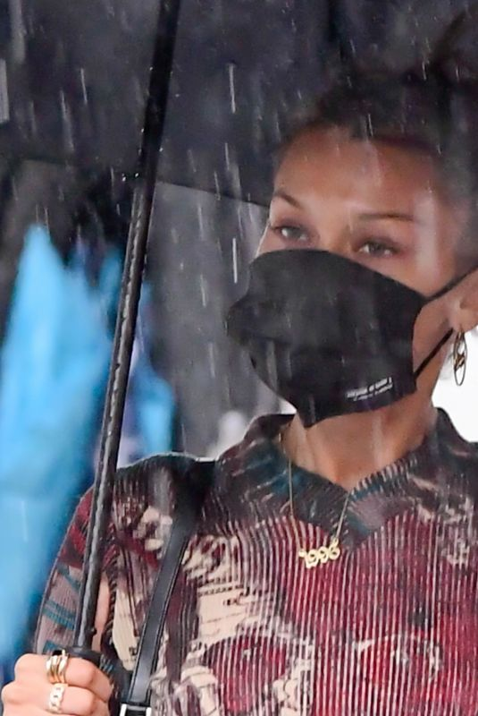 Bella Hadid Battles rainy weather while on set of the Michael Kors photoshoot in New York