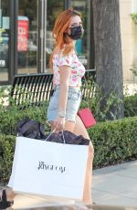 Bella Thorne Visits the Kingdom boutique in Calabasas