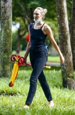 Candice Swanepoel Spends her afternoon at a local park with her two boys in Miami Beach