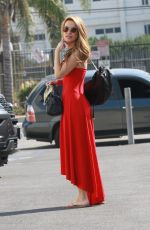 Chrishell Stause Looks lovely in a red dress as she heads to the DWTS studio in Los Angeles