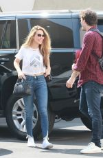 Chrishell Stause Shows off her abs as she heads in with a casual look at the DWTS studio in Los Angeles