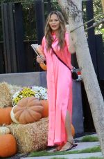 Chrissy Teigen Steps out to a pumpkin farm in a hot oink outfit
