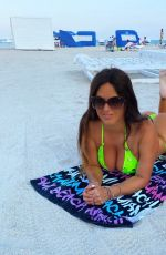 Claudia Romani Poses in a neon green bling bikini on Miami