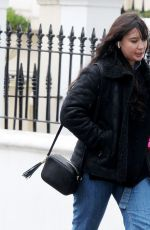 Daisy Lowe Wraps up from the cold as she walks around Primrose Hill