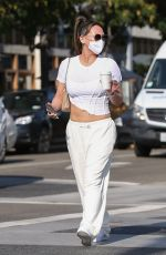 Dorothy Wang Shows her abs in a white ensemble while out on a coffee run in Beverly Hills