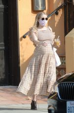 Emma Roberts Shows her growing baby bump as she steps out in Los Angeles