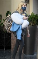 Emma Roberts Shows her growing baby bump while leaving an office building in Los Angeles