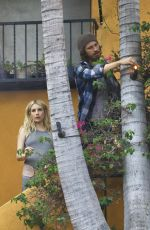 Emma Roberts Wears a maternity belt while her man works on house projects