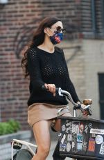 Famke Janssen Looks fashionable on a bike ride in New York