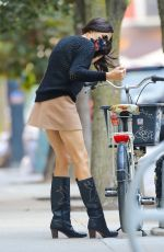 Famke Janssen Spotted pushing her bike after did picking up some Hefty trash bags in New York City
