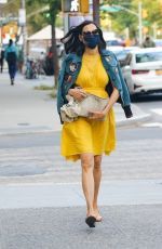 Famke Janssen Stands out in a bright yellow dress and denim jacket for a afternoon stroll through New York
