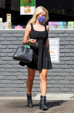 Holly Madison Looks cute as usual while matching her dark colors during a dry cleaners run
