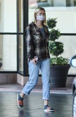 Ireland Baldwin Wears plaid shirt for a trip to a skin care clinic in Beverly Hills