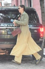 Irina Shayk Displays some cleavage as she hops into Vito Schnabel