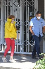 Isla Fisher Spotted with her bodyguard as she leaves the Jill Roberts clothing store in Studio City