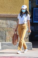 Jamie Chung Wearing colored jeans and a white t shirt as she runs errands in Los Angeles