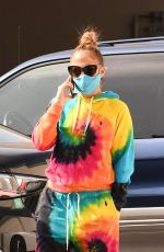 Jennifer Lopez Takes a phone call while leaving a Gucci Store in Beverly Hills