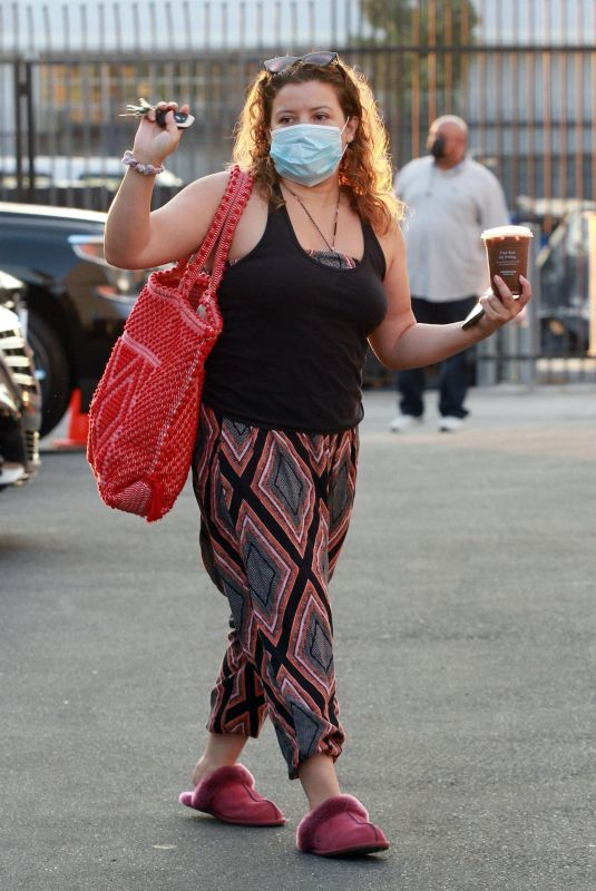 Justina Machado Arriving with a ice coffee in hand for practice at the DWTS studio in Los Angeles