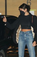 Kaia Gerber Shows off her toned abs in a crop top as she enjoys a date night at Nobu in Malibu