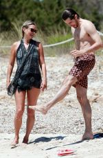 Kate Moss In black on the beach in Formentera