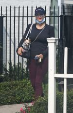 Katharine McPhee Cradles her baby bump as she shops with her dog Larry in Montecito