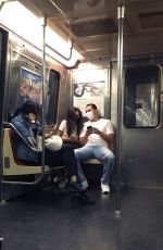 Katie Holmes And Emilio Vitolo Jr. are seen hand-in-hand while riding the Downtown Subway train in Manhattan