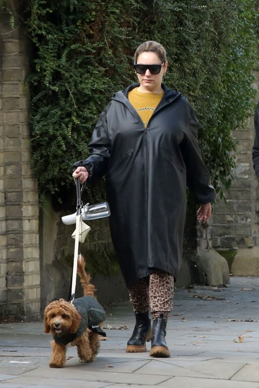 Kelly Brook And her long time partner Jeremy Parisi take their 5 month old puppy Teddy to Dandie Dog Cafe in Hampstead