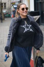 Kelly Brook Arriving at global radio wearing a blue metallic dress, high platform Ed boots and a star jumper in London