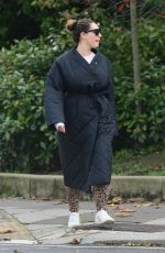 Kelly Brook Steps out looking fresh faced with no make up on, dressed in an oversized black coat out in London