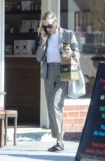 Kelly Rutherford Chats on her phone after visiting Kreation in the morning to grab herself a coffee and breakfast in Beverly Hills