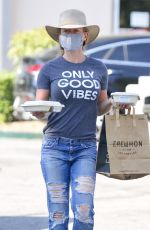 Kendra Wilkinson Wears an Only Good Vibes T-Shirt while out for lunch at Erewhon Market in Calabasas