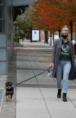 Lili Reinhart Wears a warm coat on a fall morning walk in Vancouver