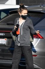 Lily Collins Gets her temperature taken as she arrives back to work in Los Angeles